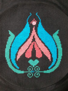 Feminist cross stitch pattern of the human clitoris